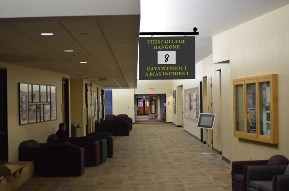 The bias incident count sign is hung in a high-traffic area just outside the college cafeteria.